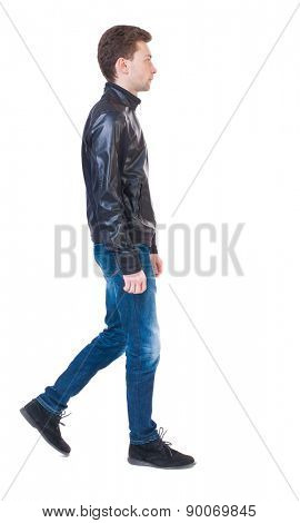 Back view of going  handsome man in jacket.  walking young guy . Rear view people collection.  backside view of person.  Isolated over white background. Sad guy in the leather jacket goes to the right