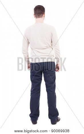 Back view of man in jeans. Standing young guy. Rear view people collection.  backside view of person.  Isolated over white background. Man in trousers and jacket standing with her hands.