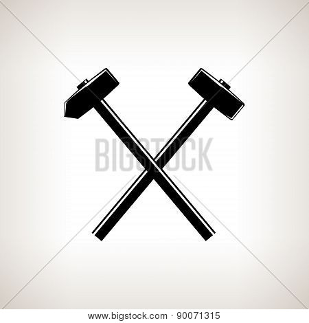 Silhouette of a crossed hammer and sledgehammer