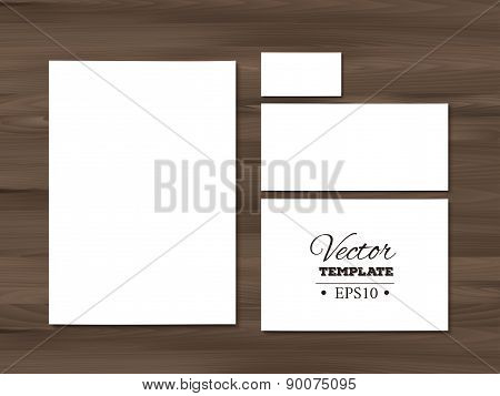 Corporate identity templates on a wooden background. Stationery