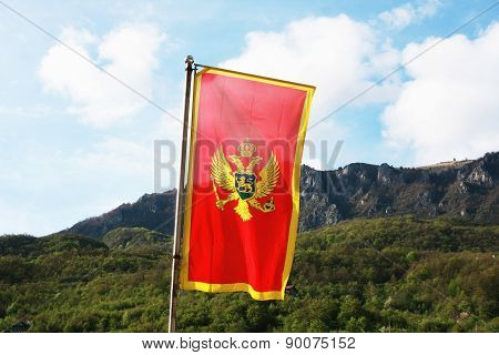 Montenegro Flag In A Front Of Mountains