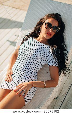 Fashion Luxury Brunette Lady Model Portrait On Sunbed