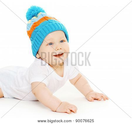 Closeup Portrait Of Smiling Cute Baby Crawls In Knitted Hat