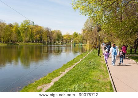 People Walking On Shore Of Pond In Catherine Park