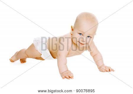 Portrait Of Baby In Diapers Crawls On The Floor
