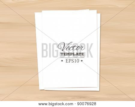Template of blank paper sheet on a wooden background