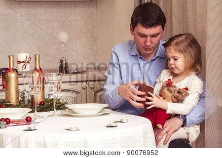 Happy father and cute little daughter