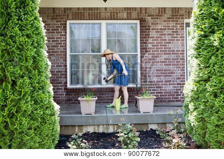Woman Washing The Exterior Windows Of A House