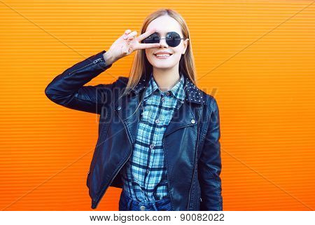 Fashion Outdoor Portrait Of Pretty Cool Girl In Trendy Rock Style Having Fun Against A Colorful Oran