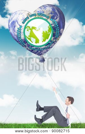 Businessman pulling a rope against blue sky