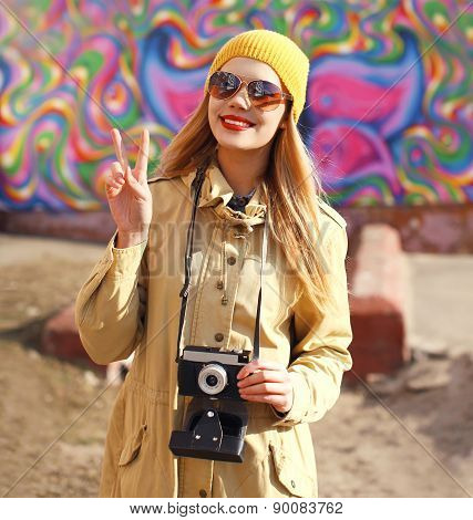 Portrait Of Happy Stylish Girl With Old Retro Camera Having Fun Outdoors