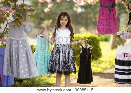 Little Girl Selecting Dresses