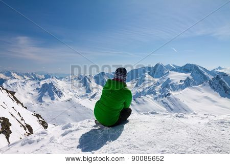 sporty woman looking to snow mountains