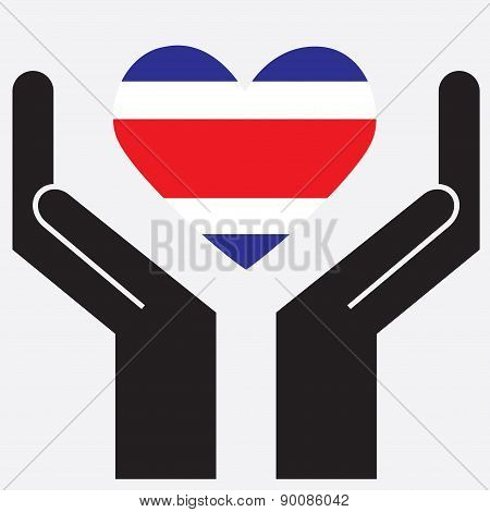 Hand showing Costa Rica flag in a heart shape.