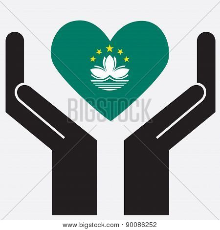Hand showing Macau flag in a heart shape.