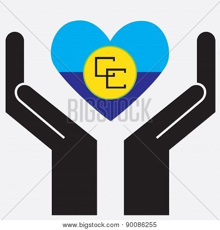 Hand showing Caribbean Community (CARICOM) flag in a heart shape.