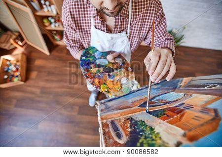 Male artist painting Venetian street