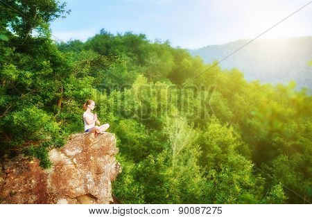 Woman Meditating In Lotus Posture, Doing Yoga On Top Of The Mountain