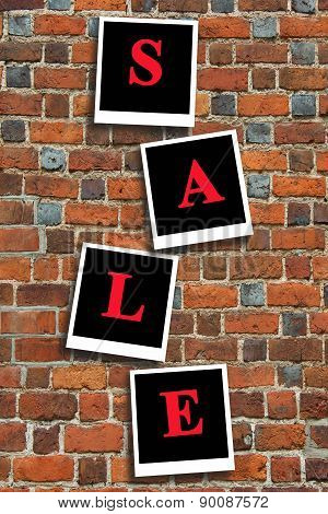 Inscription Sale On The Red Brick Wall