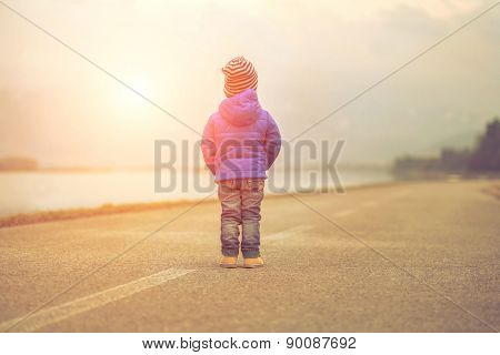 Child stay on the outdoors road