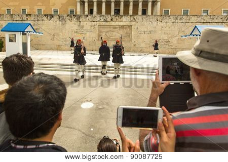 ATHENS, GREECE - CIRCA APR, 2015: Greek soldiers Evzones dressed in service uniform, refers to the members of Presidential Guard, an elite ceremonial unit, active from 1833 to present.