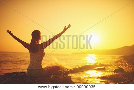 Yoga At Sunset On  Beach. Woman Doing Yoga