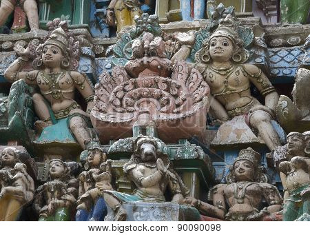Group of Statues Around Two Dwarapalakas on Gopuram.