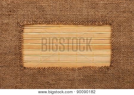 Frame Made Of Burlap Lying On A Bamboo  Mat
