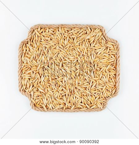 Frame Made Of Rope With  Oats  Lying On A White Background