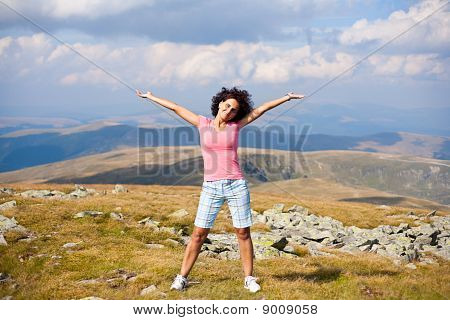 Attractive Young Lady Outdoor In Mountains