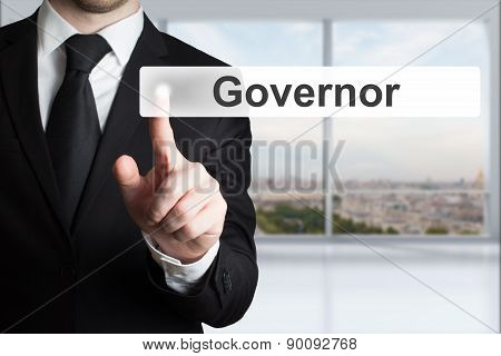 Businessman In Office Pushing Button Governor