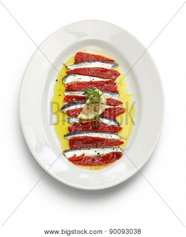 marinated anchovy and paprika isolated on white background