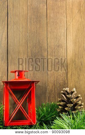 Christmas Decoration With Red Candlestick And Brown Pine Cone On Wooden Background
