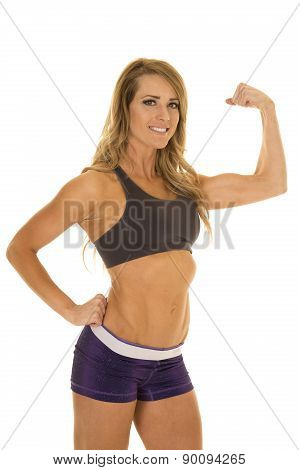Fit Woman In Purple Shorts Pose Flexing