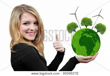 Girl holding in hand green planet with trees and wind turbines.