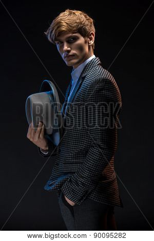 Redheaded man in a plaid suit with hat