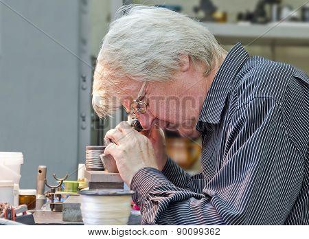 Worker Mechanic At Work.