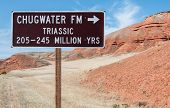 image of northeast  - A road sign identifies the type and geological period of a rock formation in northeast Wyoming - JPG