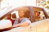 stock photo of road trip  - Group Of Friends In Car On Road Trip Together - JPG