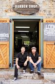 pic of facial piercings  - Portrait Of Two Hipster Barbers Standing Outside Shop - JPG