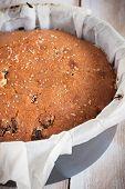 stock photo of sponge-cake  - Traditionally home baked sultana or dried fruit light sponge cake - JPG