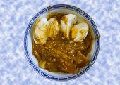pic of yoke  - Delicious Spicy egg and chicken curry dish - JPG