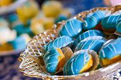 stock photo of fancy cakes  - Cakes with blue marzipan in natural light - JPG