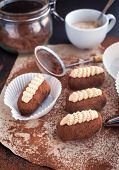 foto of cake-ball  - Chocolate rum balls cakes decorated with cream and cocoa - JPG