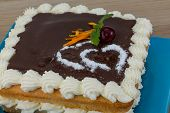 pic of icing  - Valentine Chocolate icing cake with flower and hearts  - JPG