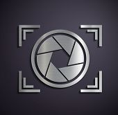 picture of megapixel  - Icon of metal camera on a gray background - JPG