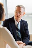 stock photo of psychologist  - Experienced psychologist talking to his female patient - JPG