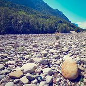 foto of bavarian alps  - Dry River Bed in the Bavarian Alps Germany Retro Effect - JPG