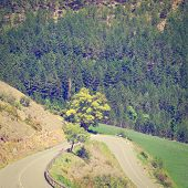 stock photo of french curves  - Winding Paved Road in the French Alps Retro Effect - JPG