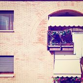 stock photo of downspouts  - Drying Clothes on the Facade of Italian House Vintage Style Toned Picture - JPG
